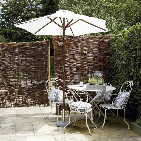 bamboo screening around outdoor dining area
