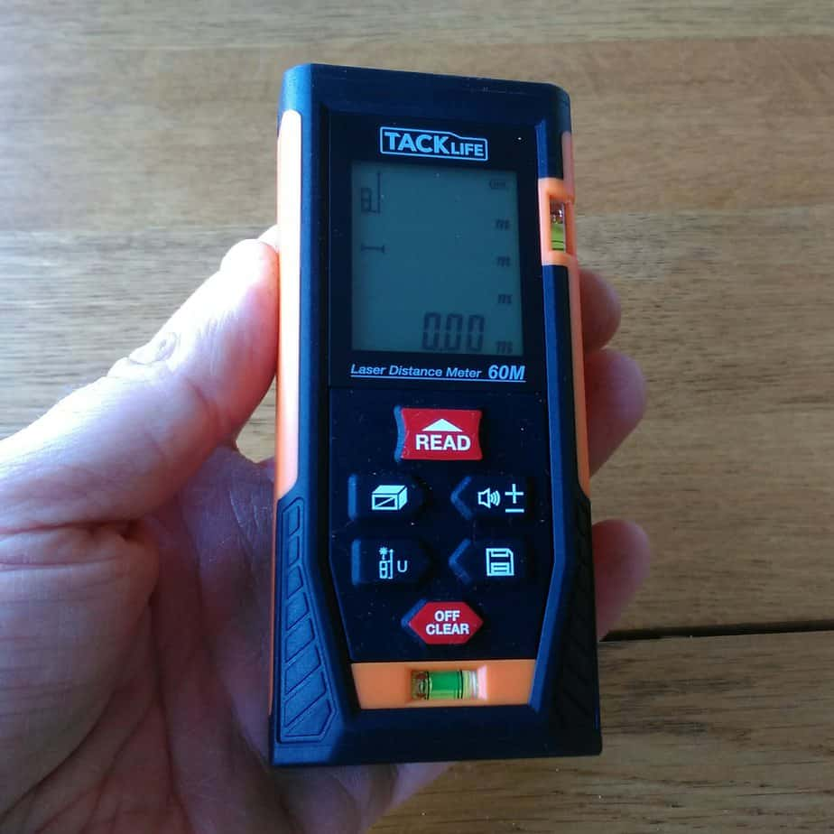 Tacklife laser distance measurer in hand