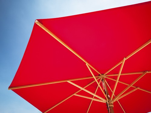 Parasol which can be placed in the centre of love seat using parasol hole.