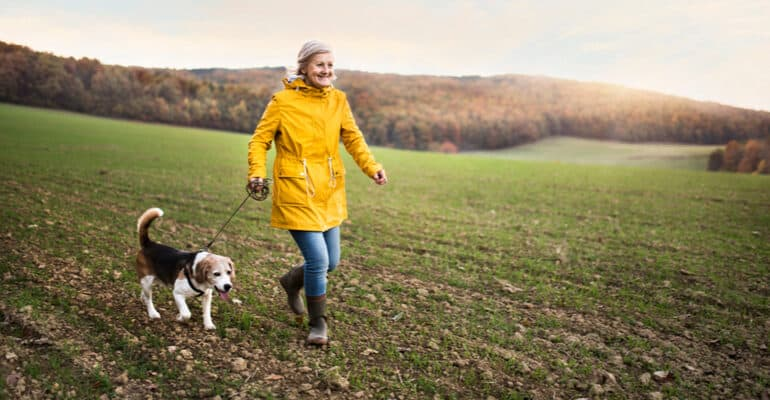Woman walking with dog in a good pair of wellies