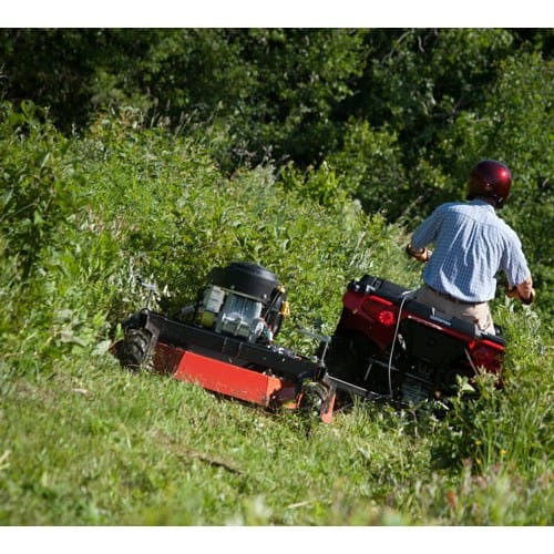DR Pro XL 44-20 ES Tow Behind Field and Brush Mower being pulled by quad