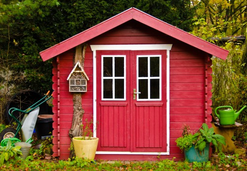 Shed painted bright red to protect from the weather and make it look good