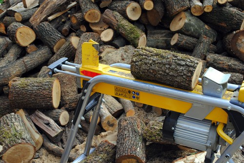 Electric log splitter being tested