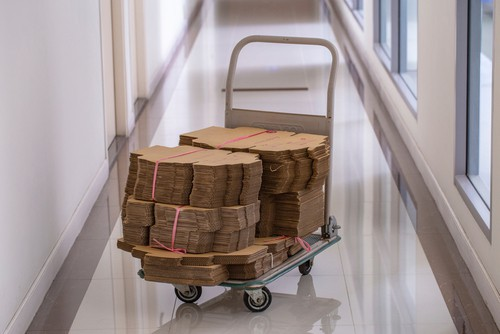 Platform trolley loaded with cardboard