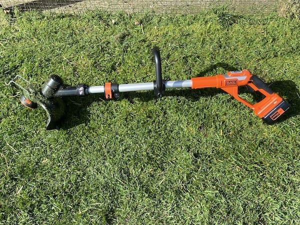 Black + Decker 36c Cordless Strimmer lay on grass