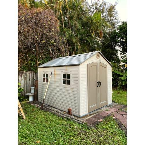 Low maintenance Plastic shed in garden