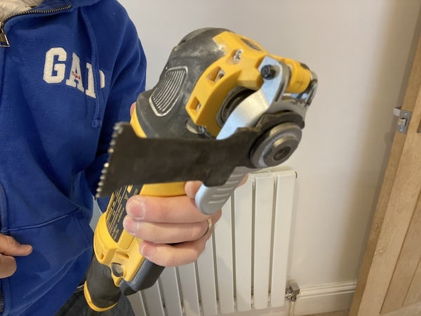 DeWalt DWE315KT Oscillating Multi-Tool with attach fitted at different position for awkward areas