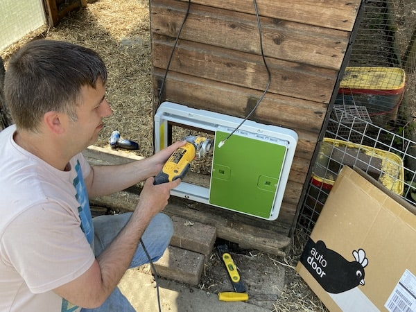 Me using the DeWalt DWE315KT Oscillating Multi-Tool to cut hole for new auto chicken coop door