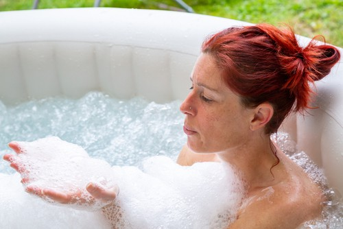 Lady in 4 person portable hot tub