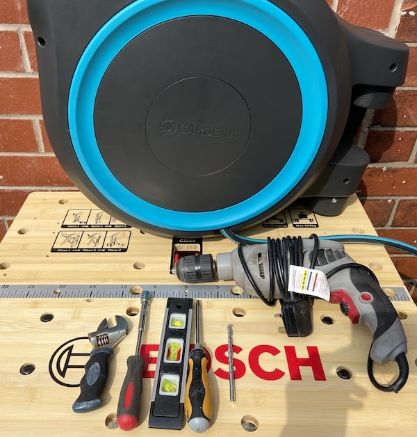 All the tools you need to install a wall mounted hose reel