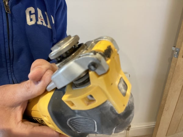 DeWalt DWE315KT Oscillating Multi-Tool in open position for inserting attachment