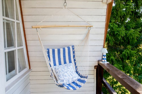 Hanging hammock chair hanging from outdoor porch