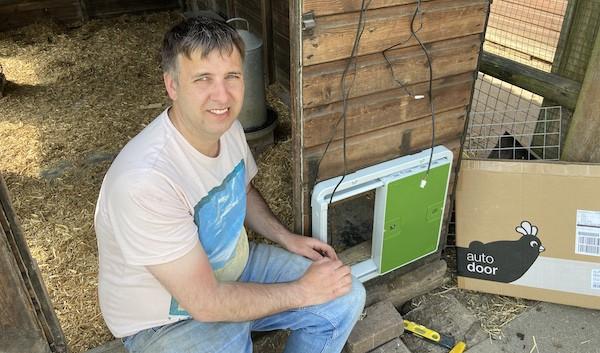 Me during installation of the new Omlet chicken door
