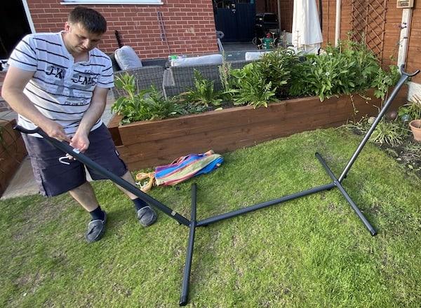 Inserting the screws the hammock will hook onto.