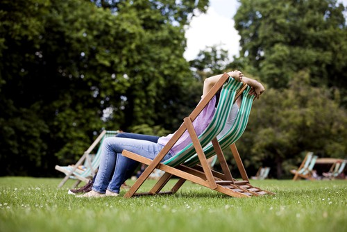 Garden deck chair being used in park as easy to carry