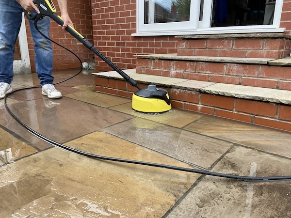 Using the included T5 Surface cleaner to clean my patio and remove the dirt