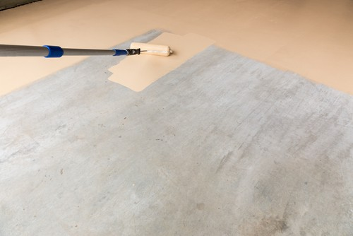 Using a long roller can make painting a garage floor much easier