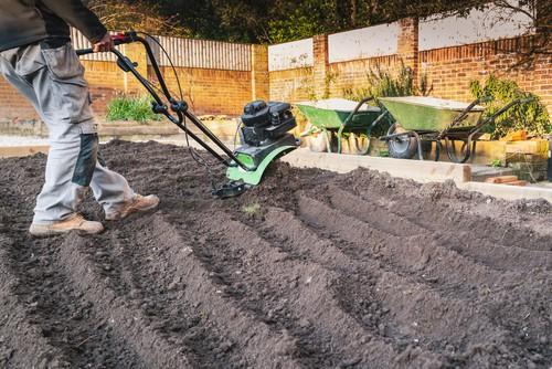 Tiller soil with mini petrol cultivator