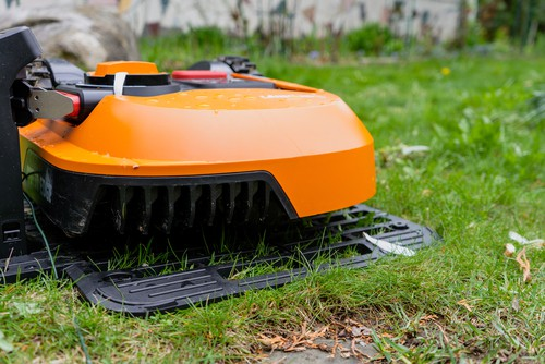 Robot lawn mower recharging on docking station which is returns to when running low automaticlly