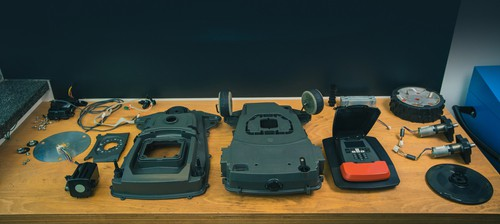 Dismantled robotic lawn mower or lawnmower