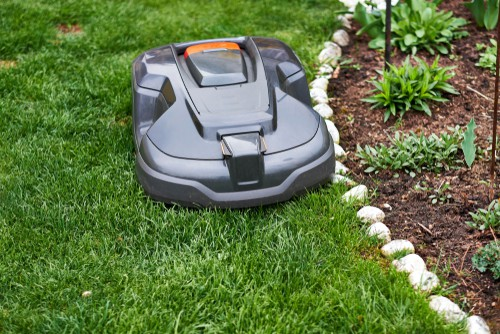 Robot lawnmowers mowing right to the edge of flowers beds and not damaging plants