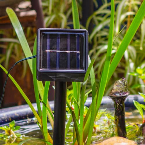 Solar panel being used to charge and power sphere water feature